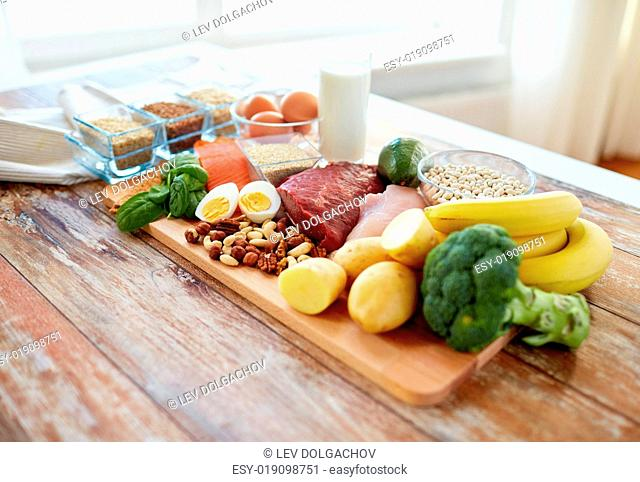 balanced diet, cooking, culinary and food concept - close up of vegetables, fruit and meat on wooden table