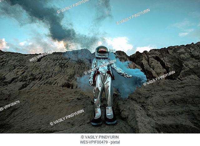 Abandoned spaceman giving smoke signals