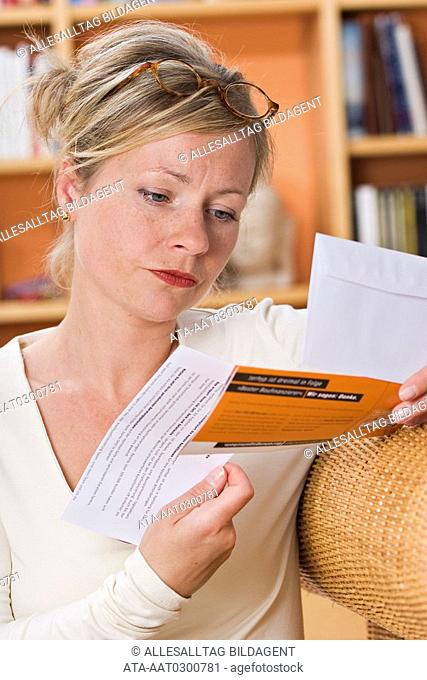 Woman studying a financial prospect