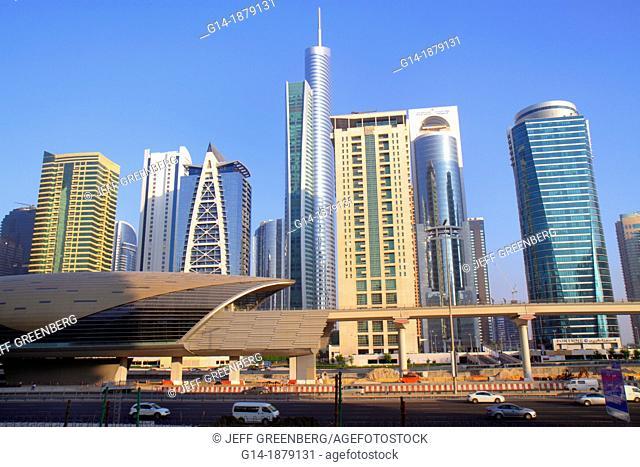 United Arab Emirates, U A E , UAE, Middle East, Dubai, Jumeirah Lake Towers Metro Station, subway, public transportation, entrance, Fortune Tower, Almas Tower