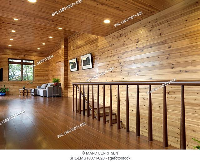 Hardwood hallway in cabin style homea