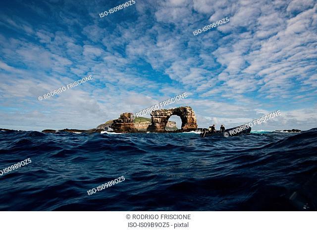 People in boat by Darwin's arch, Darwin Island, Seymour, Galapagos, Ecuador, South America