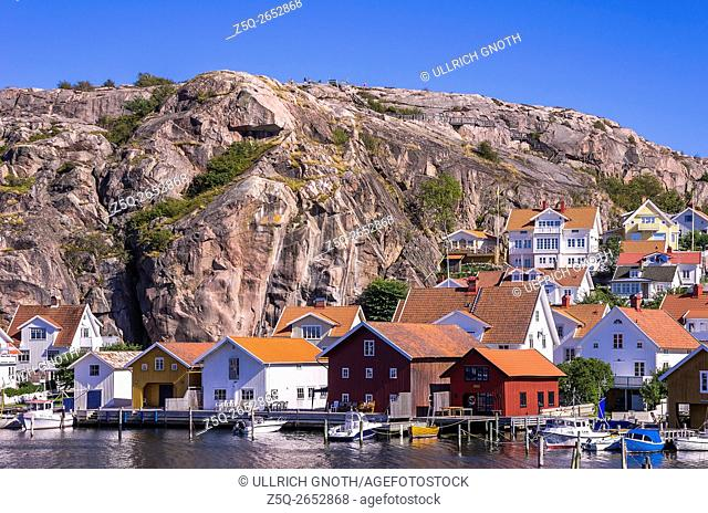 The fishing village of Fjallbacka in Bohuslan county, Sweden, overlooking boathouses and the waterfront as well as the Vetteberget cliff