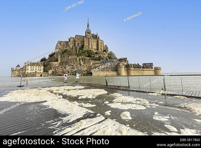 France, Manche (50), Bay of Mont-Saint-Michel, classified World Heritage by UNESCO, the Mont surrounded by water from the footbridge during a high tide