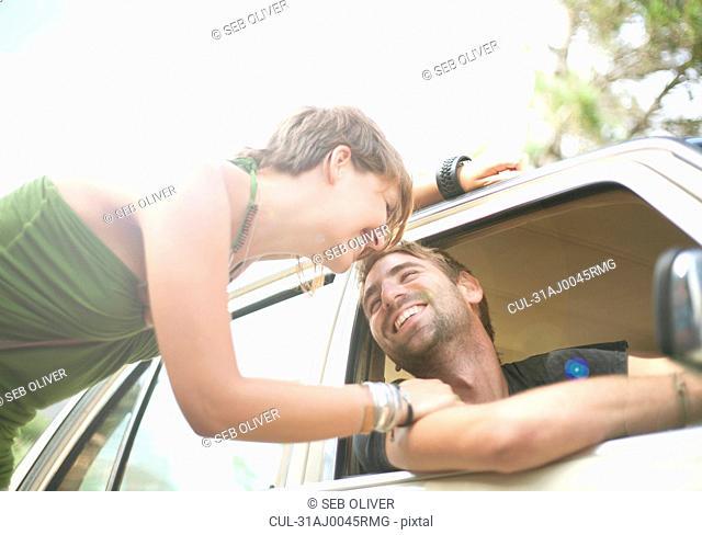Young woman and man, sharing a joke