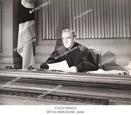 Judge holding a document in courtroom