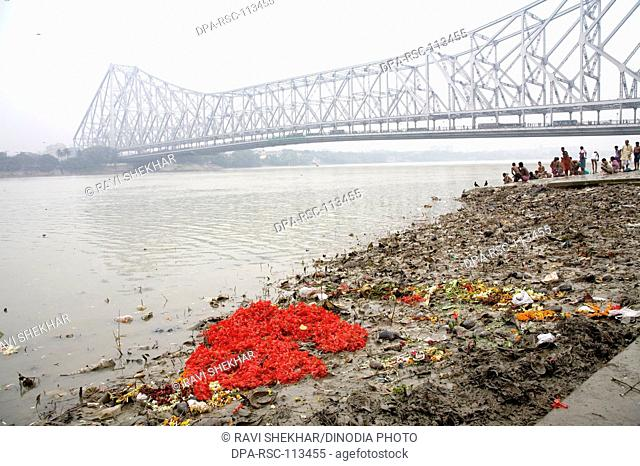Pollution on Babu ghat Howrah bridge over Hooghly river in background ; Calcutta now Kolkata ; West Bengal ; India