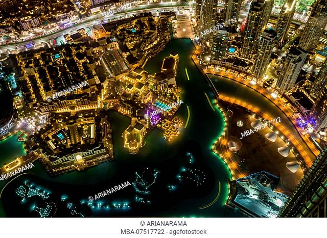 Detail aerial view at night of downtown Dubai and artificial lake, United Arab Emirates