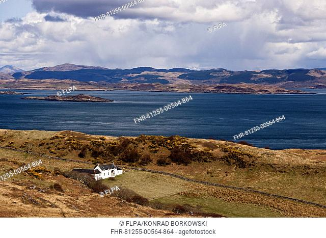 View of coastline and remote farmhouse, former home of George Orwell where he wrote 'Nineteen Eighty-Four' novel, view across Sound of Jura to mainland