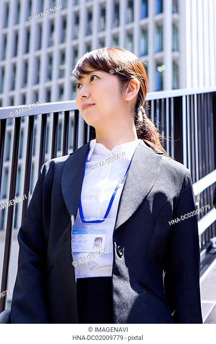 Business woman standing at downtown area