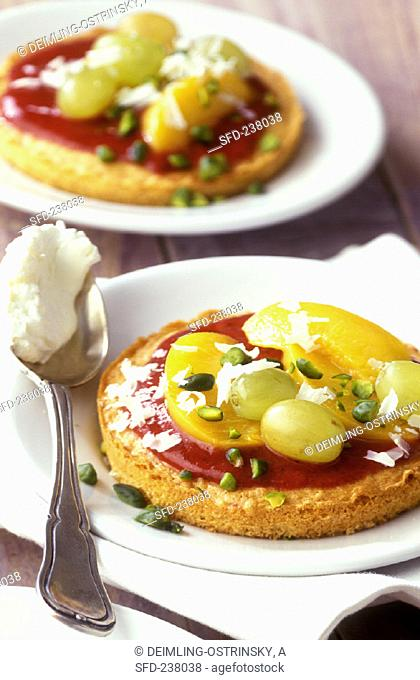 Small fruit pizzas with pistachios and white chocolate