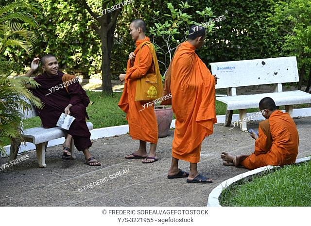 Monks in the garden of the National Museum of Cambodia,Phnom Penh,Cambodia,South east Asia