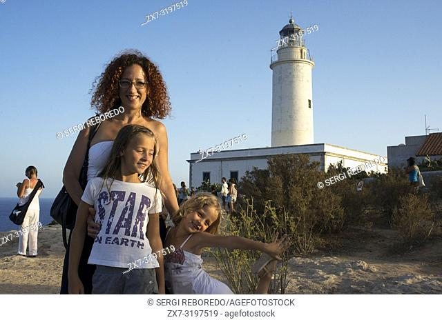 Sunset. Mother and doughter tourists in the Lighthouse, Faro de la Mola, Formentera, Pityuses, Balearic Islands, Spain, Europe
