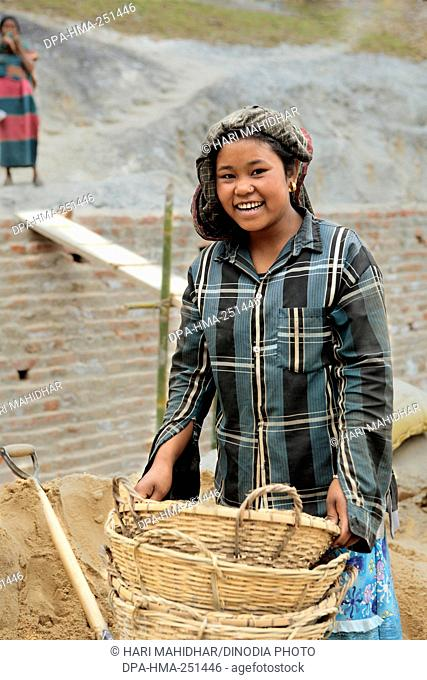 Tribal girl working on railway project site, ambassa, tripura, india, asia