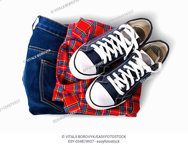 Shirt jeans and sports shoes isolated on white background