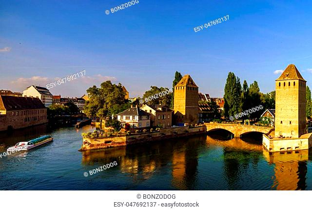 Old historical center of Strasbourg. Fortress towers and briges in Little France with reflection in the river. Touristic concept