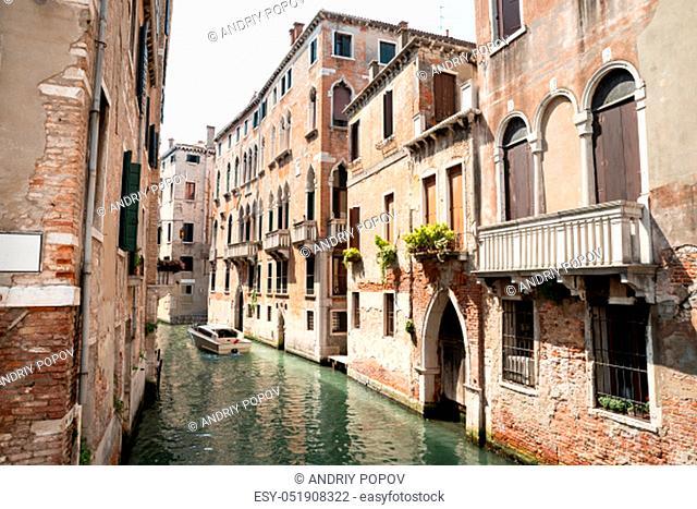 Historic Buildings Near Narrow Canal In Venice, Italy