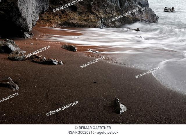 Red sand beach at Kauiki Hill in Hana Maui