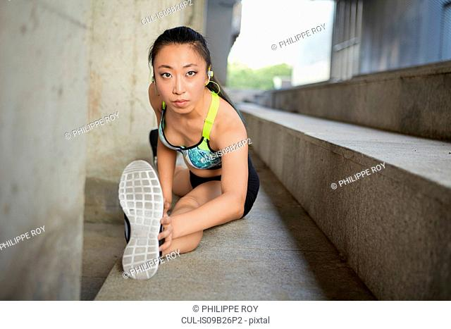 Woman doing splits on steps
