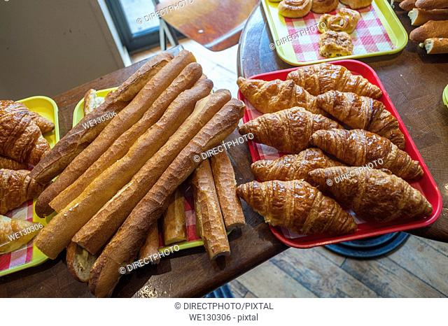 Paris, France, French Bread, Baquettes, and Croissants on display inside Bakery Shop