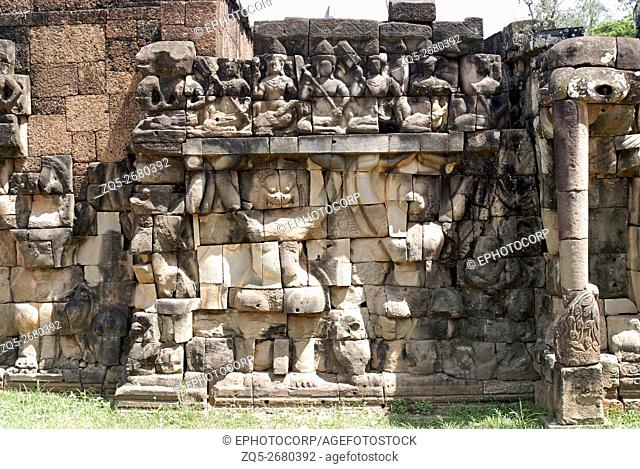 Cambodia, Preah Khan Complex 12th century A. D. Alternating Garudas and lion headed figures at the lower Level, the Upper level shows divine seated figures