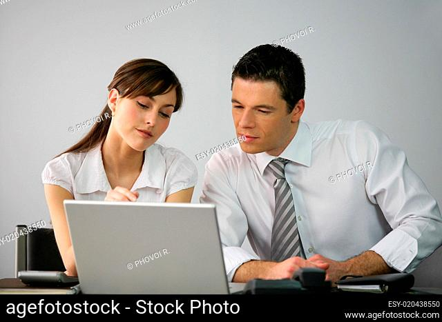Workmates in front of a computer