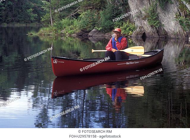 canoeing, canoe, Vermont, VT, Woman drinking a cup of coffee in a red canoe on Green River Reservoir in Hyde Park