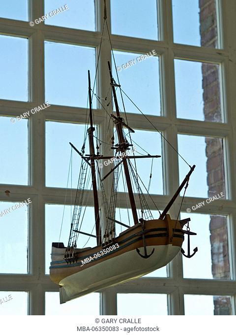 model sailing ship in chapel
