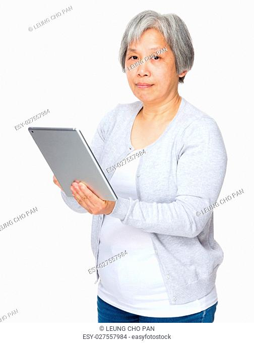 Elderly woman use of digital tablet