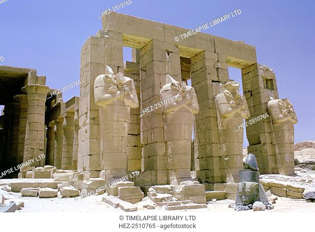 Osiride statues in front of the Ramesseum, Luxor (Thebes), Egypt. The Ramesseum is the mortuary temple of the Pharaoh Rameses II