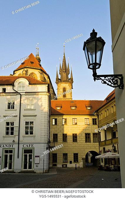 Backsite of the church of our lady before tyn and historical buildings with a latern in the early morning in Prague, Bohemia, Czech Republic