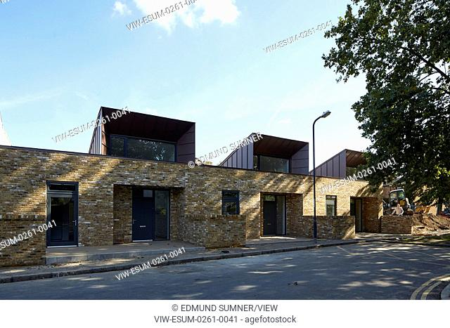 Side view of 3 units. Greenwich Housing, Greenwich, United Kingdom. Architect: Bell Phillips Architects, 2016