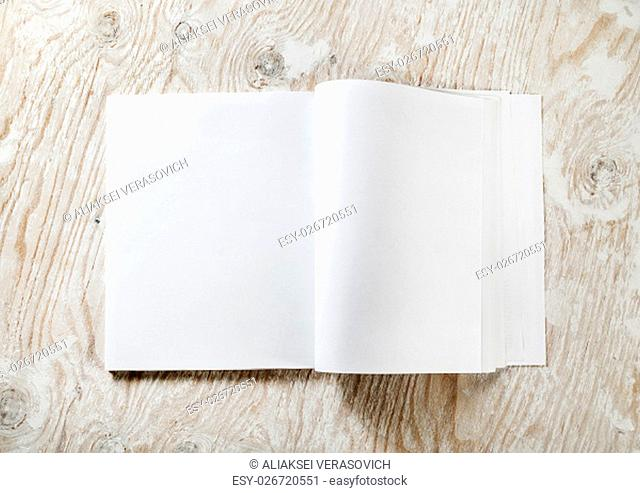 Blank opened A4 brochure magazine with soft shadows on light wooden background. Template for design portfolios. Mock-up for your design. Top view