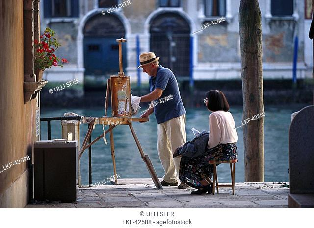 Painter and woman at Canale Grande, Venice, Veneto, Italy, Europe