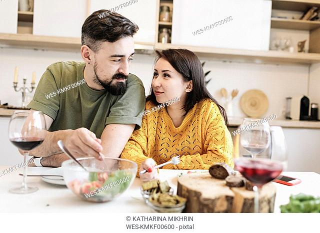 Couple in love having lunch together at home