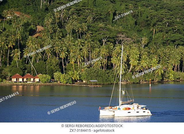 A cruise catamaran in the bay of Hamanee in Tahaa, French Polynesia, Society Islands, Pacific Islands, Pacific