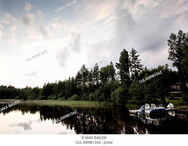 View of speedboat and lake mid summer, Orivesi, Finland