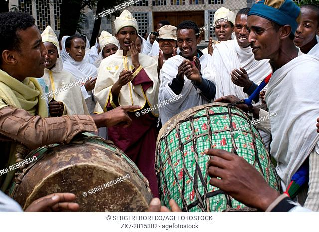 Wedding in St Mary of Zion church, Aksum, Ethiopia. The drums play in the modern church of St Mary of Zion at the time when some boyfriends are about to marry