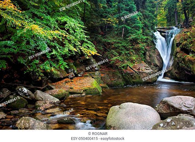 Szklarka waterfall (Polish: Wodospad Szklarki) in autumn forest, Karkonoski National Park, Karkonosze Mountains, Poland