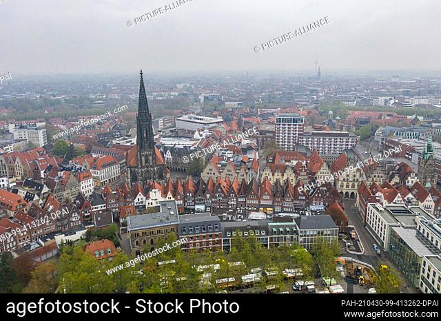 30 April 2021, North Rhine-Westphalia, Münster: A view of the Prinzipalmarkt with the St. Lamberti church (taken with a drone)