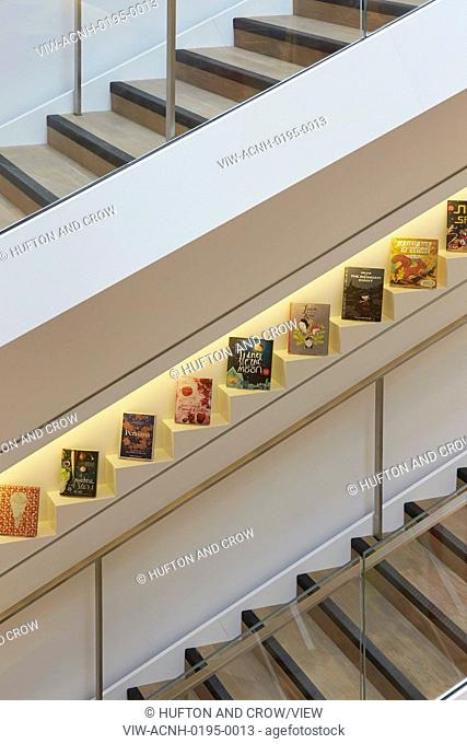 Detail of stairwell with wall-inserted book display. Foyles, London, United Kingdom. Architect: Lifschutz, 2014
