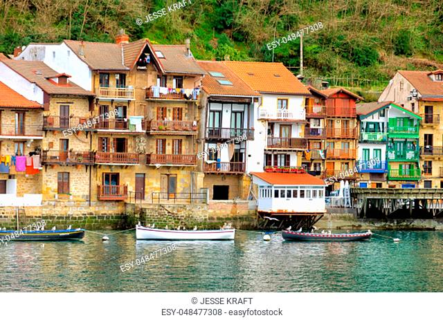 View of the fishing village along with its waterfront and boats in Pasai Donibane, Spain