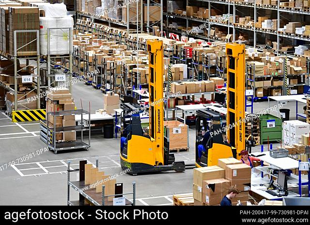 16 April 2020, Brandenburg, Großbeeren: High racks and two electric high-bay stackers from Jungheinrich at the logistics service provider Rhenus Warehousing...