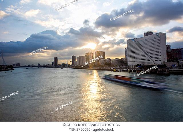 Rotterdam, Netherlands. Nieuwe Maas River dividing North and South parts of the city by sunset