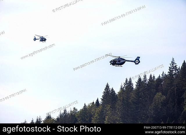 13 July 2020, Baden-Wuerttemberg, Oppenau: Two police helicopters fly over the forest near the community of Oppenau. With a large contingent