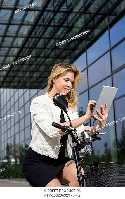 Woman business tablet computer electric scooter