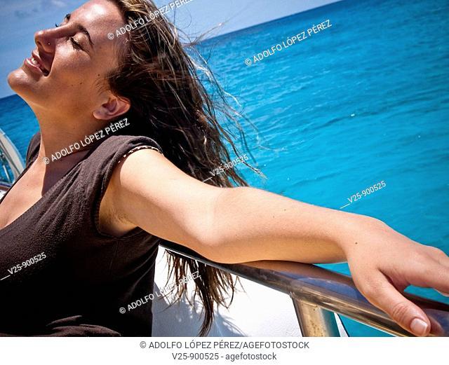Woman basking in the sun. Dominican Republic