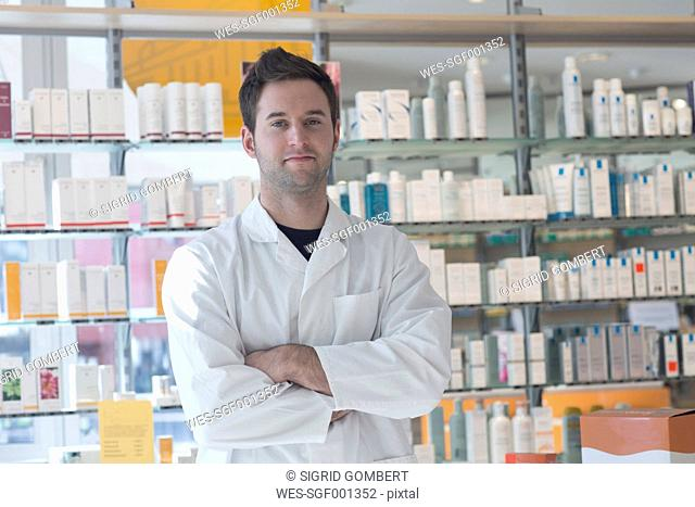Portrait of confident pharmacist in pharmacy