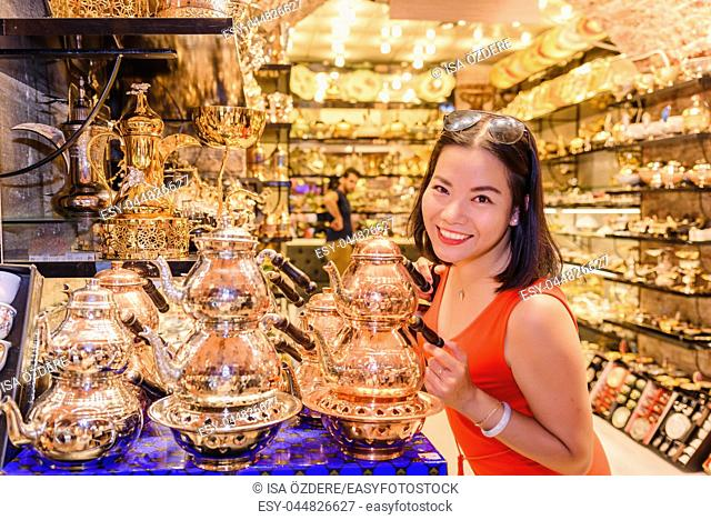 Beautiful Chinese woman poses in souvenirs shop at Egypt Bazaar in Eminonu,Istanbul,Turkey
