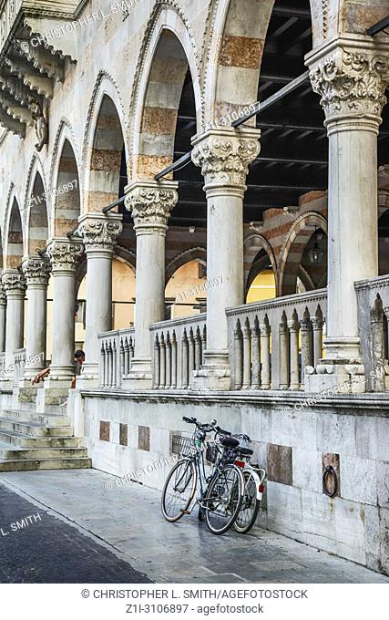 Bicycles outside the Loggia del Lionello in the Piazza della Liberta in Udine, Italy